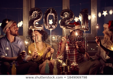 Young couple enjoying for Christmas or New Year time at home. stock photo © ijeab