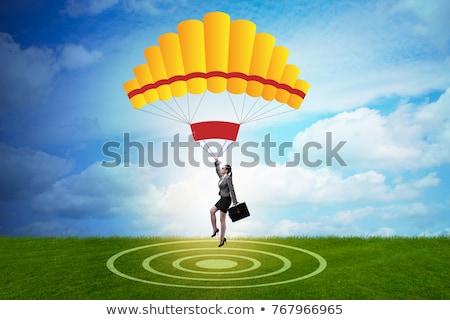 деловая женщина парашютом женщину Финансы доллара Сток-фото © Elnur