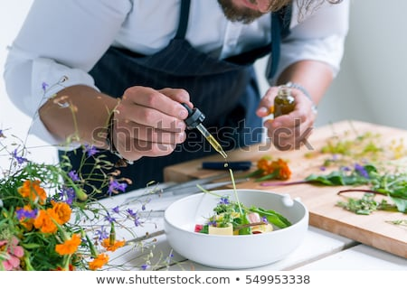 Zdjęcia stock: Group Of Chefs Preparing Food In Kitchen At Hotel