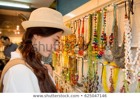 The girl with the Philippine pendant Stock photo © galitskaya