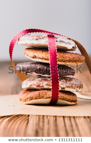 A few gingerbread cookies wrapped in red ribbon on wooden table stock photo © przemekklos