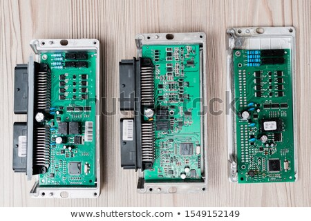 Overview of three demounted gadgets on wooden table ready to be examined Stock photo © pressmaster
