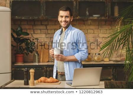 ストックフォト: 午前 · ニュース · ハンサム · 若い男 · 飲料 · コーヒー