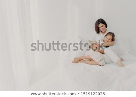 Fotó nyugodt fiatal anya lánygyermek szeretet Stock fotó © vkstudio