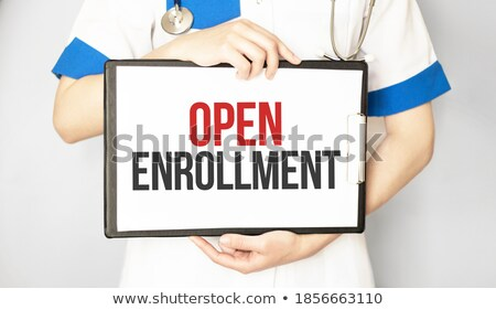 Woman Holding Card With Open Enrollment Text Stock photo © AndreyPopov
