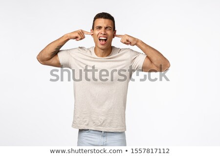Angry and annoyed athletic young man close ears with fingers, yelling and grimacing bothered, tellin Stock photo © benzoix