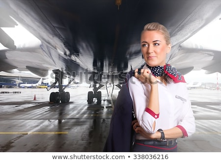 Stock photo: flight attendant near moving ramp