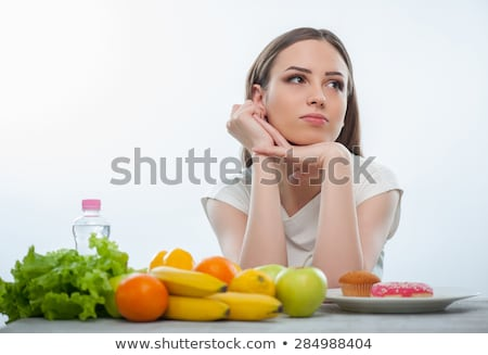Pensive Woman With Fresh And Canned Vegetables Stock photo © Amosnet