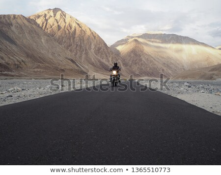 Lone motorbike rider Stock photo © mikdam