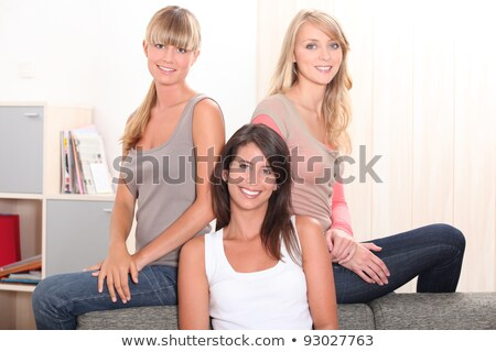 three female housemates relaxing on sofa stock photo © photography33