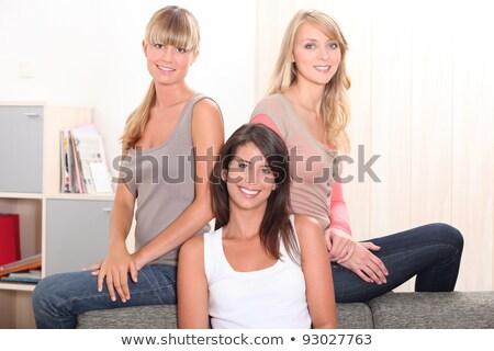 Három női megnyugtató kanapé boldog otthon Stock fotó © photography33