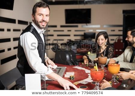 Yakışıklı kumarbaz adam tablo oynama poker Stok fotoğraf © lunamarina