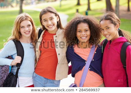 Portrait of young girl embracing stock photo © get4net