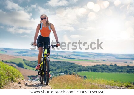 young woman doing mountain bike in the country Stock photo © photography33