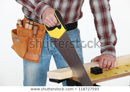 mason holding handsaw and plank of wood stock photo © photography33