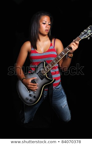 mixed race teenager with electric guitar stock photo © photography33