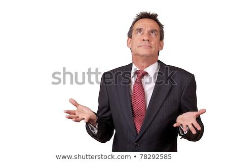 Exasperated Business Man in Suit Raising Eyes Stock photo © scheriton