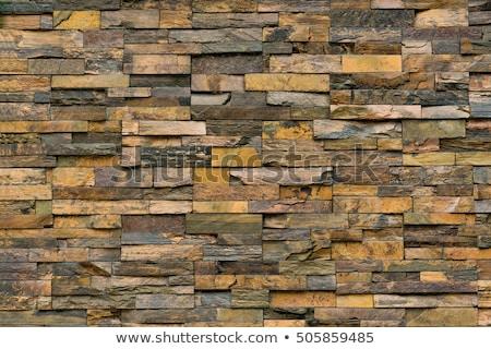 reddish stone wall stock photo © prill