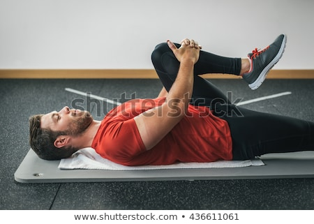 Man stretching on the floor Stock photo © photography33