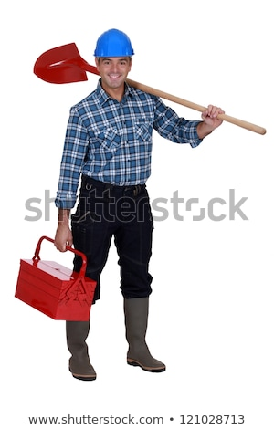 Mason carrying spade and tool kit Stock photo © photography33
