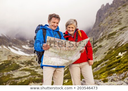 couple hiking with map in mountains stock photo © blasbike