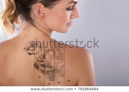 Tatuagem de volta mulher jovem isolado corpo cabelo Foto stock © acidgrey
