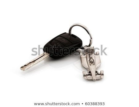 Keys to the car with trinkets in the form of a car. Stock photo © inxti