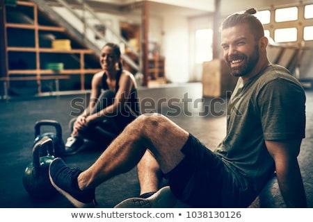 nevet · sportos · nő · ül · padló · gyönyörű - stock fotó © dash
