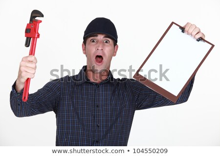 Outraged plumber holding clip-board Stock photo © photography33