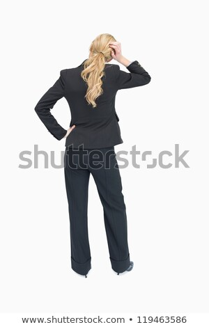 Standing businesswoman thinking while holding her hand on the head backwards Stock photo © wavebreak_media