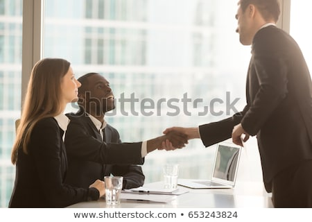 Businessman sitting at a desk talking to you Stock photo © photography33