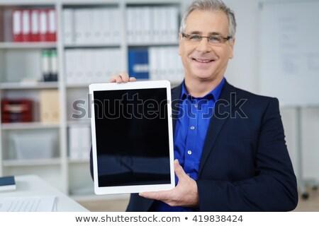 business man presents empty screen tablet stock photo © feedough