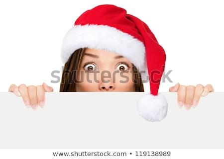 asian girl in santa peeking over paper sign board stock photo © szefei