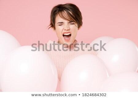 Angry Woman celebrating birthday with balloon Stock photo © Kzenon