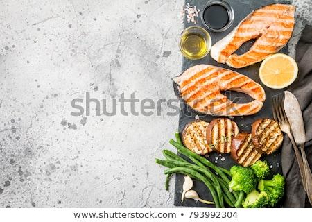 Grillezett lazac steak vágódeszka izolált fehér Stock fotó © karandaev