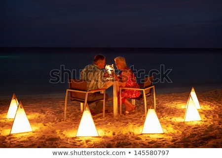 Stock photo: Senior Couple Enjoying Late Meal In Outdoor Restaurant