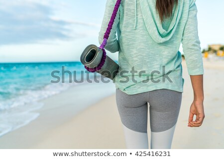 Fit woman carrying exercise equipment Stock photo © stryjek