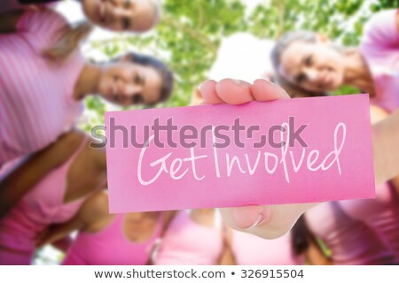 Woman with pink ribbon balloon Stock photo © sognolucido