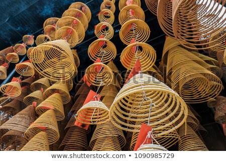 Burning spiral incense stick in temple. Stock photo © kyolshin
