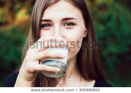 Cara mulher potável leite caucasiano hispânico Foto stock © phakimata