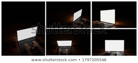 Criminal Using Laptop To Hack Data At Table stock photo © AndreyPopov