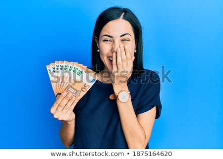 Beautiful Woman Happy Smiling Holds Hands Over Face Embarrassed Stock photo © cboswell