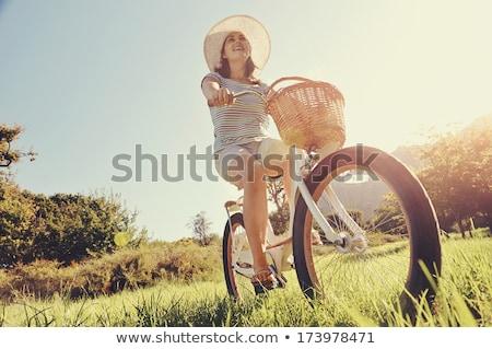 Nő klasszikus bicikli vidék fiatal szőke nő Stock fotó © dariazu
