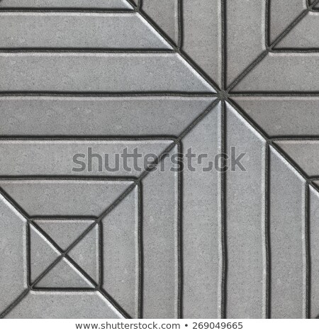 gray paving slabs rectangles of varying lengths laid in a square stock photo © tashatuvango