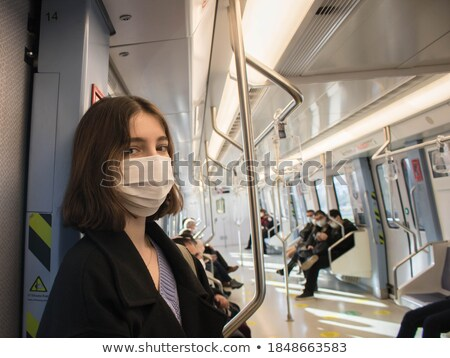woman on subway stock photo © kasto