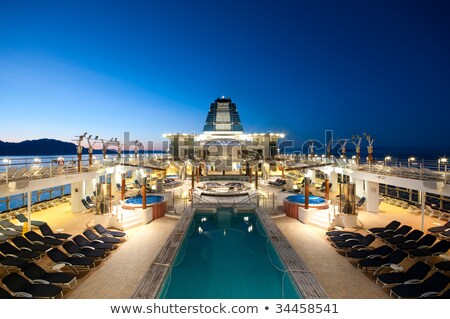 Salon cruiseschip fauteuil zonsondergang zee oceaan Stockfoto © smuki