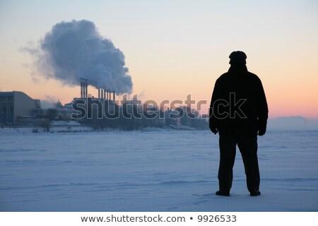 férfi · áll · fagyott · folyó · dohányzás · csövek - stock fotó © Paha_L