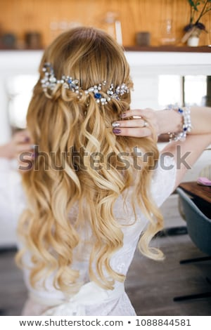 beautiful young woman with wavy long hair in wedding dress stock photo © deandrobot