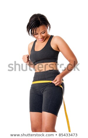 Excited happy young woman celebrating success and measuring her hips  Stock photo © deandrobot