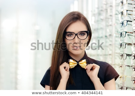 Elegant Bowtie Woman with Cat Eye Frame Glasses in Optical Store Stock photo © NicoletaIonescu